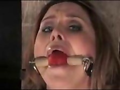 Busty Girl Sitting On Electric Dildo While Tied To Timber Mouthgag Whipped Pussy Stimulated With Vibrator In The Dungeon