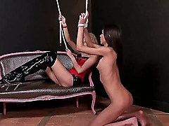 Skinny long haired blonde and brunette lesbians Nataly Gold and Teena Lipoldino with small tits in provocative outfit enjoy having bondage master and servant fantasy in black room