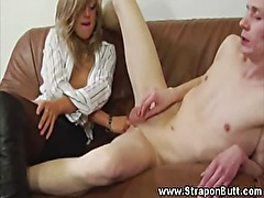 Domina fingers his tight ass before she fucks it with a strapon