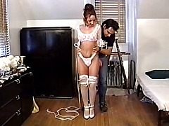 Cute hottie with a smoking hot rack bound for BDSM session