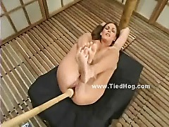 Woman with large nipples bound in bdsm