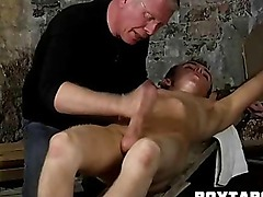 Horny tied up hunk having his hard cock tugged on