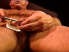 CBT built bear punishes his own balls.